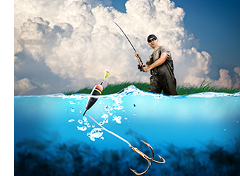 Man fishing standing in water with three pronged hook