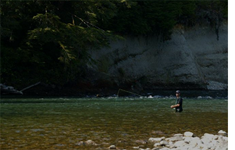 Man in waist high water fishing by himself